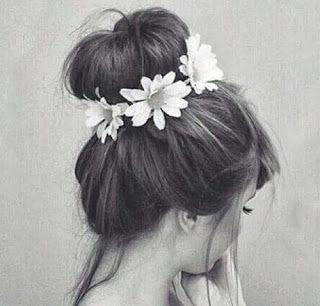 bun & flowers. Love the pixie look!