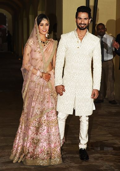 The wedding clothes of Mira Rajput, all created by Anamika Khanna, lit up the internet this week with admiration. Here's she's in perfect pink with Shahid Kapoor. Thx Vogue.in