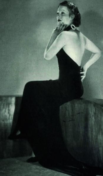 """Everything from cinema to silk came with a spirit of nationalism. The Italian diva Isa Miranda models """"very Italian"""" dresses in a series of 1935 pictures intended to prove the tautological idea that """"Italian elegance is most suitable because it's the best."""""""