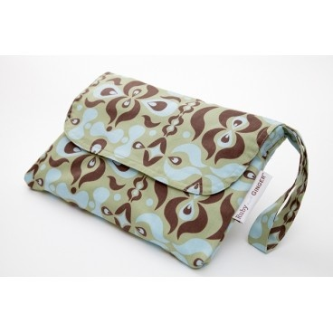 one of our Ruby and GINGER Nappy Purses (because you still need to carry nappy but might as well do it in style!)