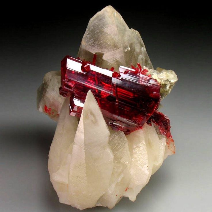 Realgar clapsed by translucent Calcite scalenohedrons, from Jiepaiyu Mine, China