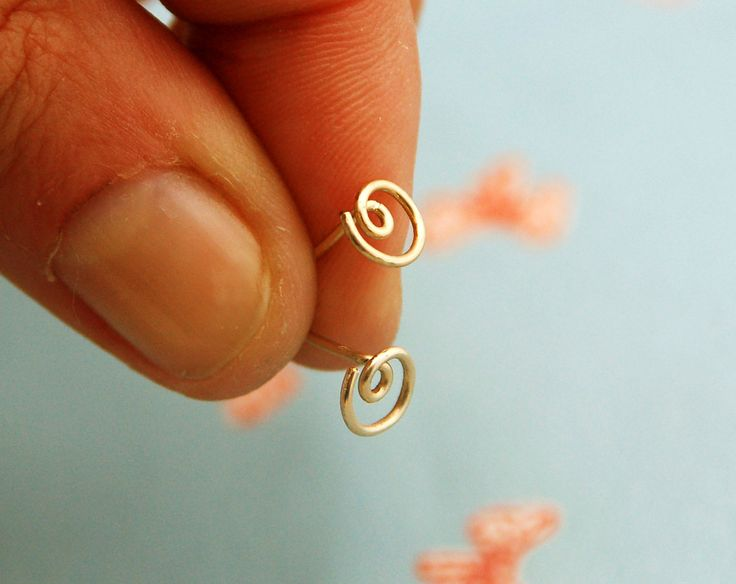 Spiral stud earrings, small post earrings 14k gold filled, silver tiny studs, circle post earrings, gold circle, wire wrapped stud. $10.00, via Etsy.