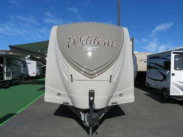 2016 New Forest River Wildcat 28 RKX Travel Trailer in California CA.Recreational Vehicle, rv, 2016 Wildcat 28 RKX 2016 Wildcat Travel Trailer Options: Beautiful Marble interior color, slate edition, garden room (includes free standin table), 8 cu ft refrigerator, rear ladder, 50 amp service and 2nd A/C prep, 15k BTU ducted roof A/C w/heat pump, livingroom fireplace, solid surface kitchen countertop, wood plank flooring, rear backup camera system, maxx travel rack, electric tongue jack…