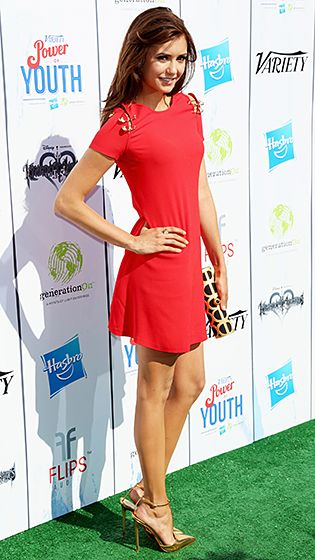 Red-Hot on the Green Nina Dobrev made a splash on the green carpet in a bright red frock at Variety's Power of Youth event at the Universal Studioes Backlot on Saturday, July 27.