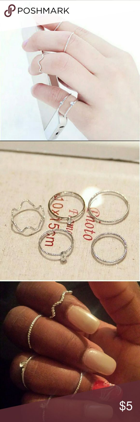 5 Piece Midi Ring Set in silver! Midi rings are very popular right now! They are rings made to fit above the knuckles. This set comes in silver and has 5 pieces! However 1 ring came slightly unperfected and can be seen in the last pic. Not a big deal! Just means can pretty much fit on any finger! Jewelry Rings