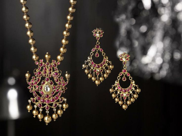 indian necklace and matching earrings with magenta stones