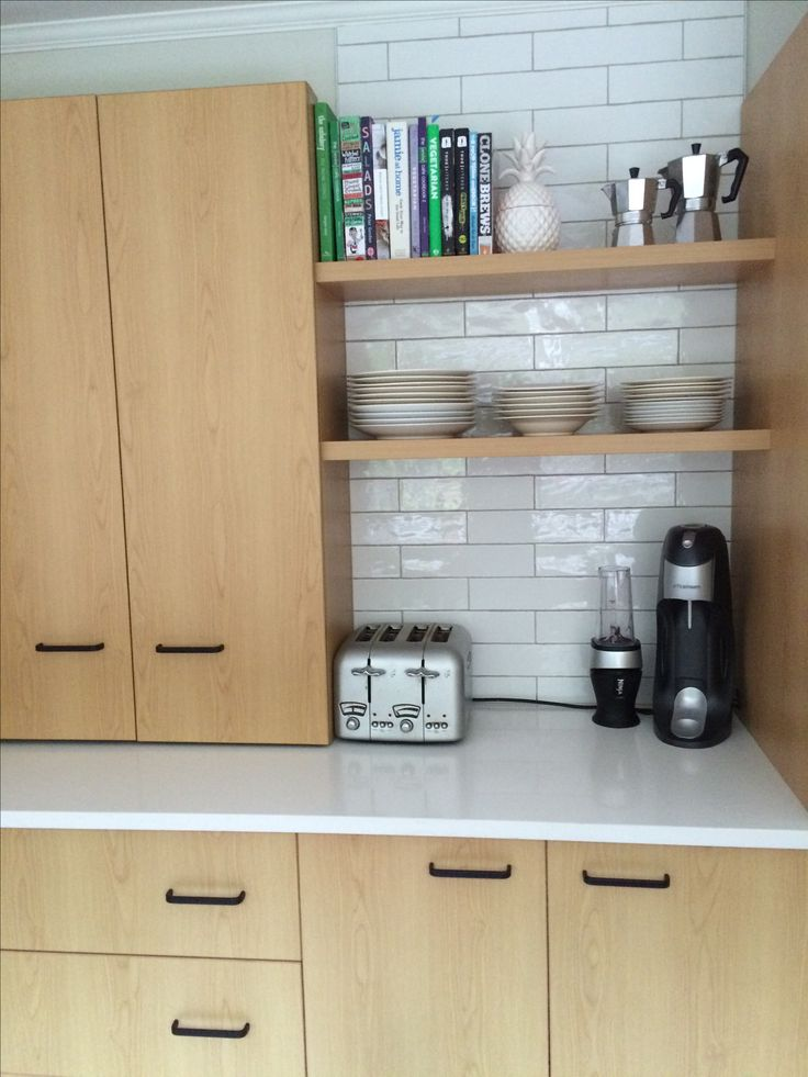 Heavy cupboards removed... Tiles and custom shelves added.