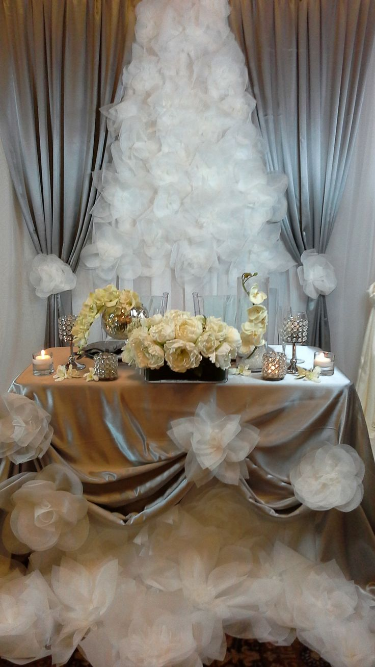 backdrop and bridal table with oversized paper flowers, silk flowers and crystal candle holders; design by Davis Floral Creations