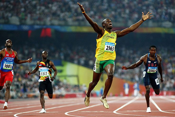 Usain Bolt, after crossing the finish line of the men's 200m final, shows his delight at having won the Olympic gold medal and beaten Michael Johnson's world record