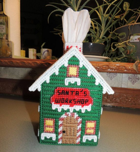 Handmade from plastic canvas Christmas themed Santas Workshop tissue cox cover. Fits botique style tissue box. This item comes with a box of tissues. Please note: This item is made to order there are none in stock.