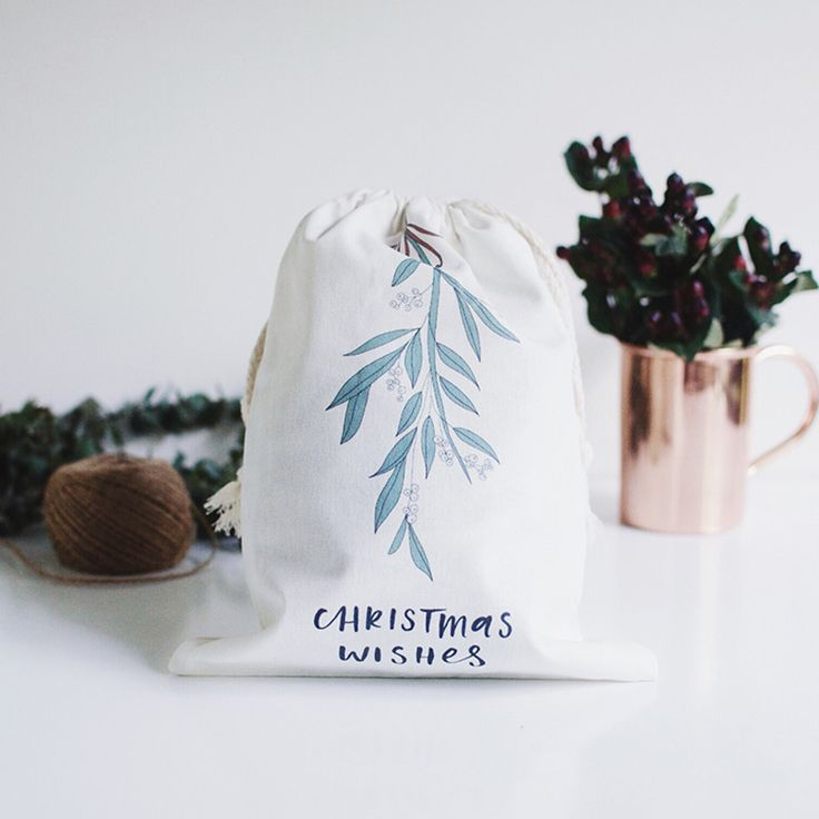 Made of quality thick canvas and printed with our beautiful illustrations and hand lettering, these bags make the perfect addition to your already amazing gift. Throw away the tacky paper bags and wrapping paper and make your presents pop with these reusable gift bags. #howardsstorage  #christmaswishlist
