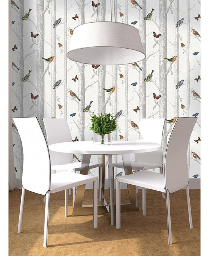 This stunning Birds on Branches Wallpaper features a detailed collection of beautiful birds and butterflies in rich vibrant colours, set on a forest themed background of trees and branches in grey and white.