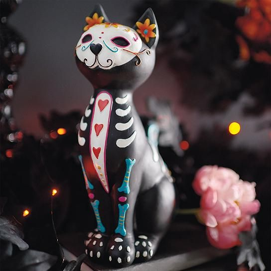 Say hello to our chillingly charming Sugar Skull Cat  the next utterly purrfect addition to your Halloween or Day of the Dead d. She's equal    parts fanciful and fierce. A miniature work of art. Masterfully and elaborately hand painted, from nose to tail, with vivid and authentic Day of the Dead    sugar skull designs. In wonderful contrast, hints of a skeleton structure add just the right level of spookiness. One look at this colorful creature    lurking around your lair, and guests wil...