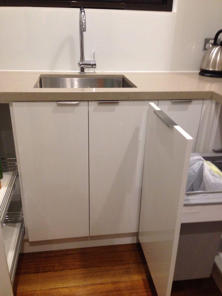 Servo assist installed to bin drawer
