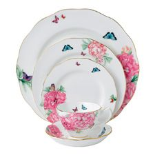 Features: -Set includes: Dinner plate, salad plate, bread and butter plate, teacup and saucer. -Designed by Miranda Kerr. -Material: Fine bone china. -Dinnerware sets. -Hand wash recommended. -G