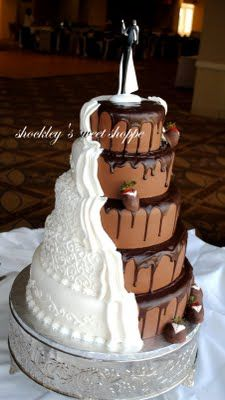 Half traditional white wedding cake, half chocolate grooms cake, beautifully and artistically