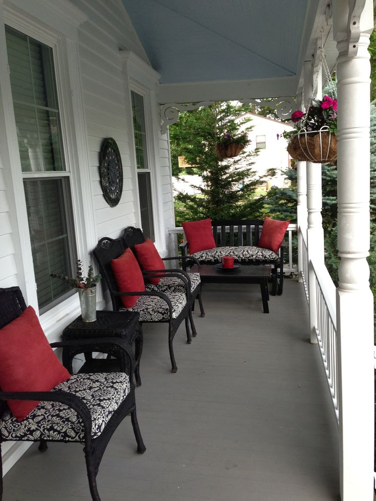 Black Wicker Front Porch -- I spray painted my wicker furniture black and bought new cushions and pillows.  I love it!