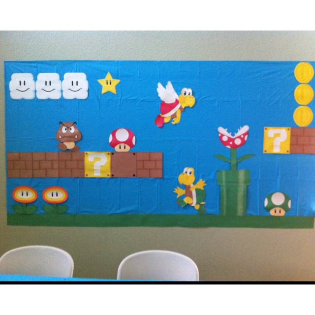 Super Mario birthday themed backdrop made from construction paper.