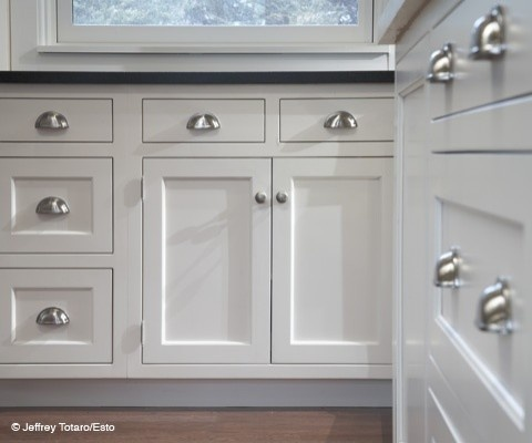 Cabinet hardware:  cup pulls on the drawers is a must!