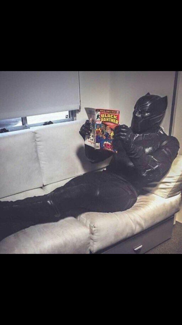 And here we have the best photo ever. Chadwick Boseman in his Black Panther costume, reading a Black Panther comic.