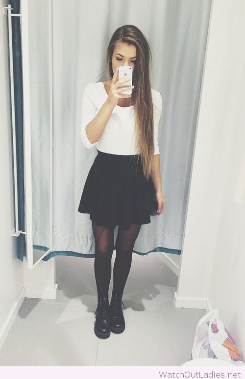 Black skater skirt with white long sleeve shirt. Some tights to go underneath and some combat boots. I'm pretty sure those are combat lolz