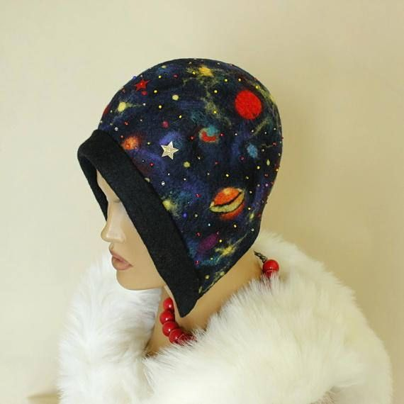 One of a kind, very elegant and light hat with motifs of cosmic. Decorated with tiny beads of different colors Hat-cap style of the 1920s.   Adapts to the head. It is hand felted, made using only natural materials: wool merino and soap( Savon de Marseille)  Circumference: 22⅞ inch / 58cm