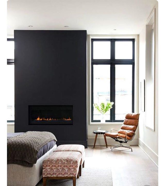 I nooo that summer is nearing but with this miserable rainy day it made me fall in love with this bedroom. Who wouldnt want a fire place in there bedroom am i right!!??? #interiordesign #interiordecor #bedroomfireplace #blackfeaturewall #notmydesign #insp