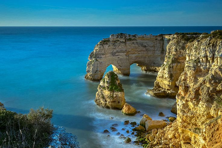 Backed by a tall cliff sculptured by the effects of erosion, the beauty of Marinha Beach in the Algarve, Portugal has been ranked as among the top 100 worldwide (by Luis Ascenso Photography) - http://www.ealgarve.com/attractions/praia-da-marinha/
