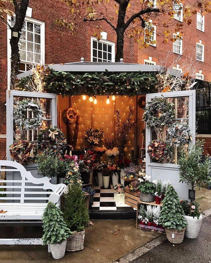 Flower Shops Christmas Flowers In 2020 Flower Shop Interiors London Christmas Lights Flower Shop Display