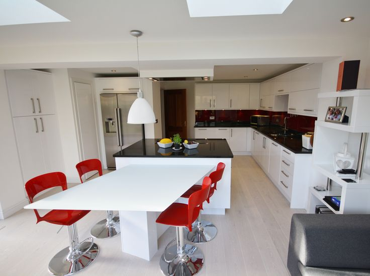 Second Nature white gloss with red accessories and splash backs. Designed, Supplied and Installed by KITCHENCRAFT Witham, Essex
