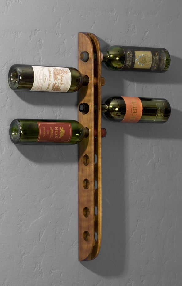 Wall mounted Wine Rack--Sculpted from a piece of solid Walnut.