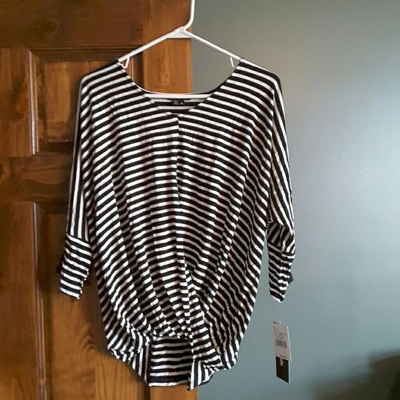 NWT Black and white short sleeve top Black and white short sleeve top with fun black contrast at sleeves. Waist has sort of a wrap style. 96% Rayon, 4% Spandex.  Machine wash, tumble dry. New with tags My Michelle Tops