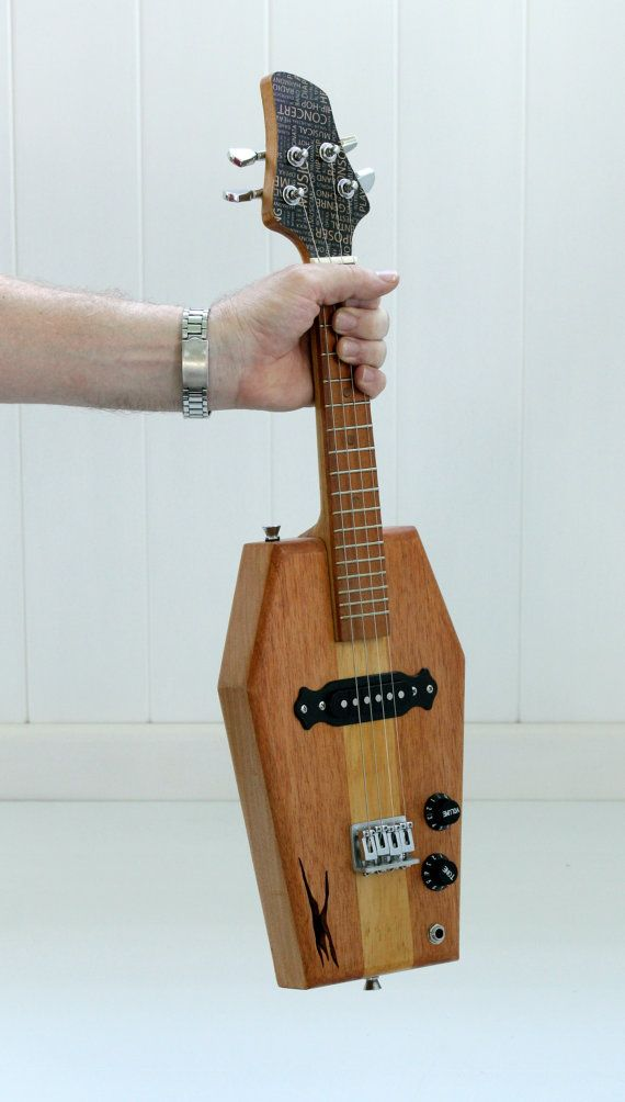 Ukuleles by Honni Music  Unique hollow body steel string electric ukulele, with the option of a concert or tenor scale neck. The body is light weight