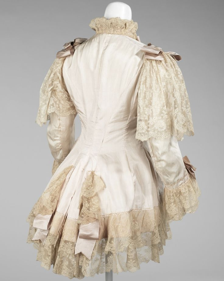 Dressing Jacket 1885 Featured, is an excellent example of a dressing jacket from the period of the late 1880s to the mid-1890s. The combinat...