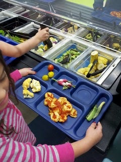 Filling trays with more fresh foods in Boulder Valley Schools, Colorado.  #schoolfoodsrule