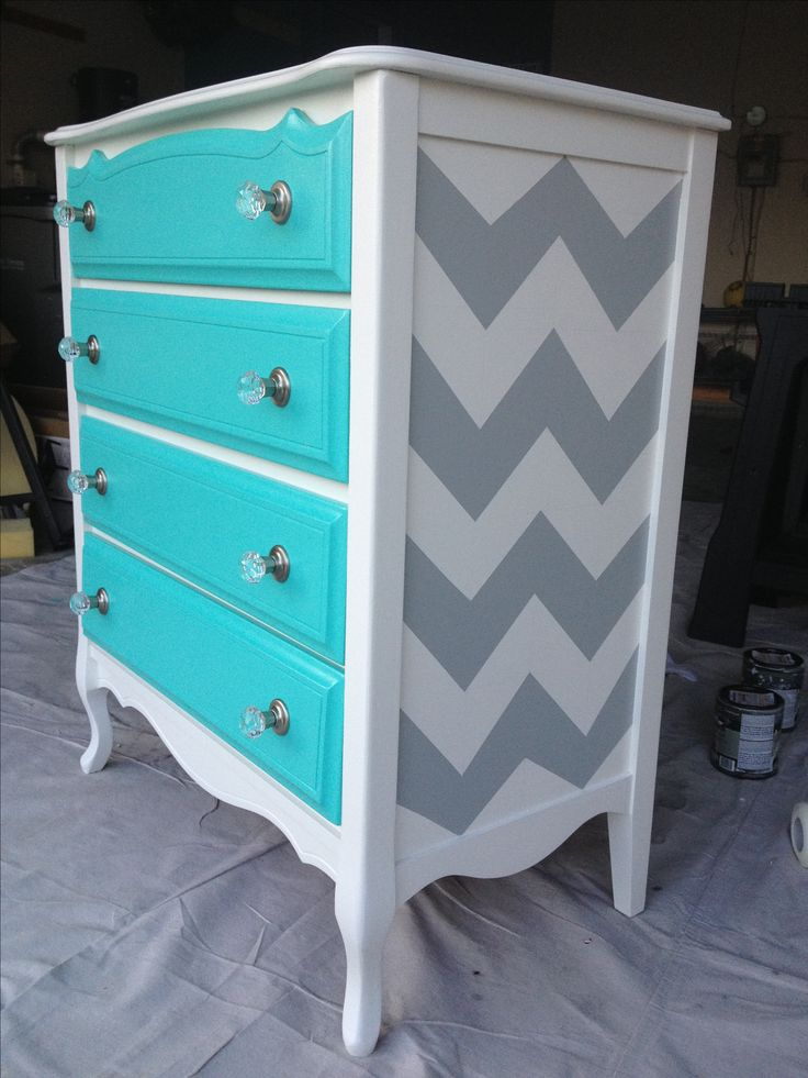 "Second hand find turned fabulous with ""Pool Blue"" from Pottery Barn on the drawers (I had Home Depot custom match the colour from a fabric sample) and grey chevron on the sides. This beauty was someone else's trash and I turned it into a new treasure for my daughters bedroom.  I think I'm in love!!"