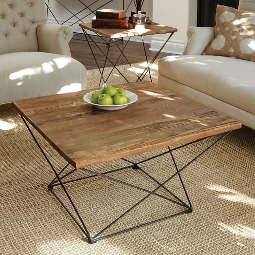 Hip to be square. With a top made of solid reclaimed pine, the Angled Base Coffee Table's angular iron legs give it a light, airy appearance. Simple and square, it's an easy fit with any style.
