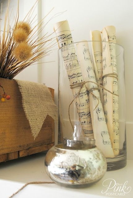Hymns: Pages from old hymn books rolled and ties with twine and placed in a vase.