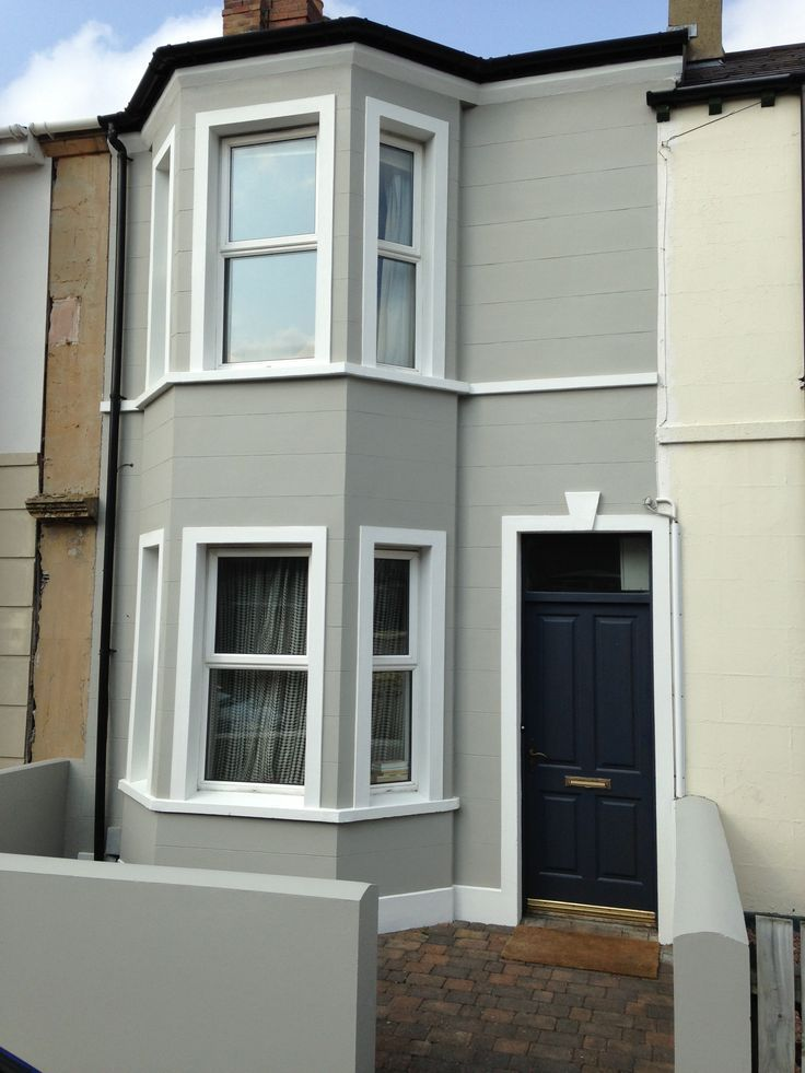 House exterior painted in hardwick white with front door for Modern exterior colours