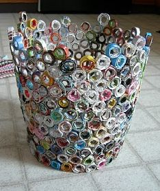 Recycled Magazine Trash Can. Neat idea. Roll up pieces of old magazines, hot glue them together. Jeez, sounds complicated.... But a neat idea Ill never do! Lol