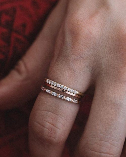 ✨The secret to a good stack: Contrast. Make your fingers pop with different textures, metals, and diamond shapes ✨ Featured (Top to Bottom): the Good Stone French Pavé stacker, 1mm polished Plain band, and the Dainty Baguette stacker. Shop online via link in the bio. Tag your girls!