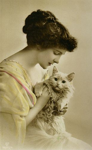 Woman with a white cat
