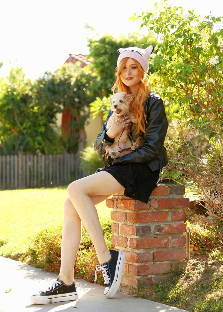 People 1450x2027 women model redhead long hair women outdoors pet Katherine Mcnamara actress hat portrait display looking at viewer leather jackets short skirt legs Converse animals dog sitting bricks trees sunlight smiling