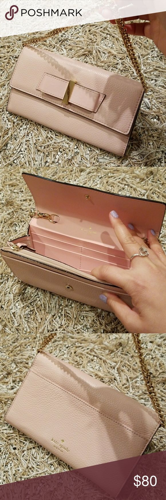 Wallet with chain Like new cute blush pink bow wallet with chains..easy to take on a go kate spade Accessories