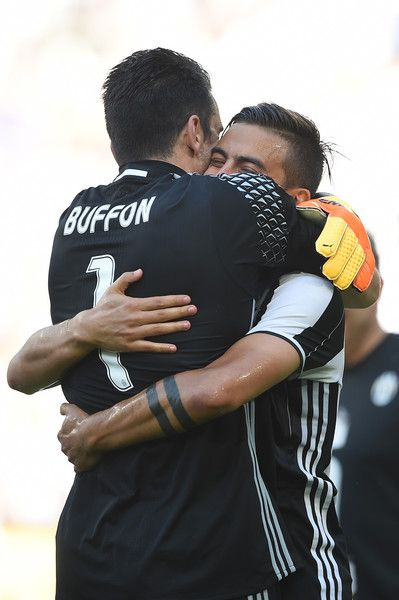 "Juventus' goalkeeper from Italy Gianluigi Buffon (L) celebrates with Juventus' forward from Argentina Paulo Dybala after winning the Italian Serie A football match Juventus vs Crotone and the ""Scudetto"" at the Juventus Stadium in Turin on May 21, 2017. First-half goals from Mario Mandzukic and Paulo Dybala, and a late header from Alex Sandro sealed a 3-0 win over Crotone to hand Juventus a record sixth consecutive Serie A title today. / AFP PHOTO / Filippo MONTEFORTE"