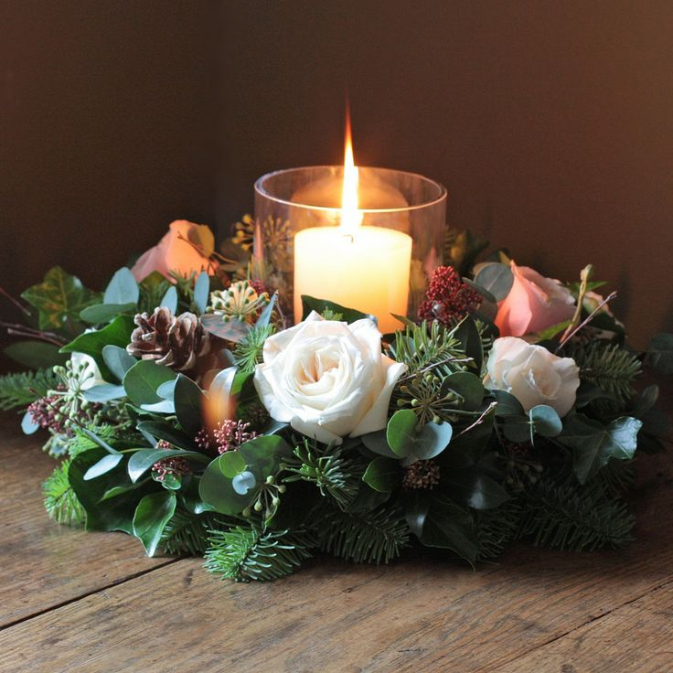 The Real Flower Company Scented Woodland Christmas Table Wreath is a beautiful arrangement that brings a woodland wonderland style to your table. With a combination of scented rose heads arranged with skimmia, pine cones, birch arranged on a base of berried ivy, ivy trails and parvifolia. This door wreath will have a diameter of around 13 inches. To complete the look select the large hurricane lamp and candle from the perfect little extras below. If you are decorating your home for Christmas…