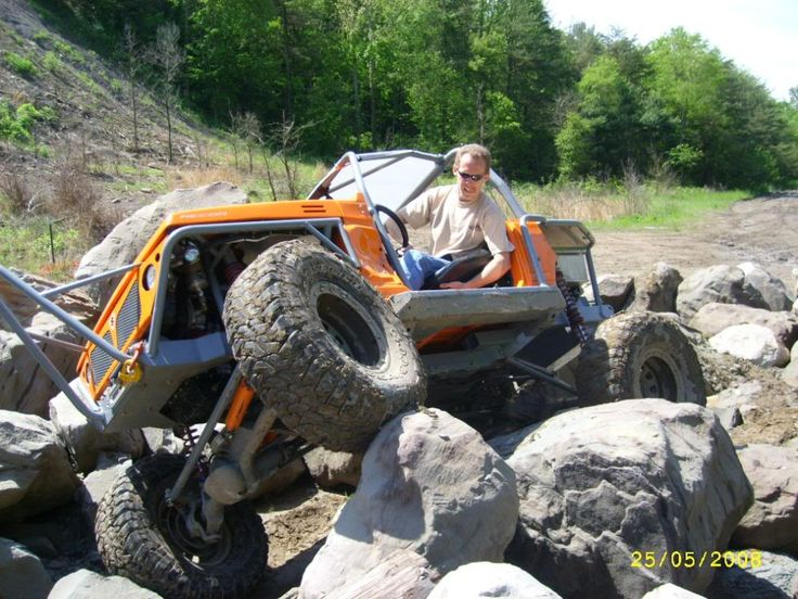 Suzuki Samurai Rock Crawler. I need a lawnmower like this.