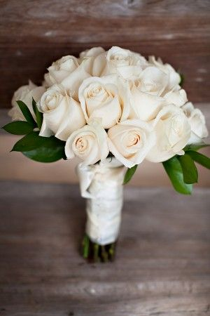 Make a timeless statement with an all white rose wedding bouquet. | Mary Kay