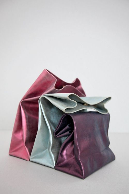 Where was my metallic lambskin lunchbag when I needed one? Cool foldover clutch idea