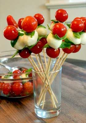 Kids will have fun picking their favorite arrangement of cherry tomatoes, fresh mozzarella and basil to make these Tomato Pops! #KidsCookMonday #MeatlessMonday